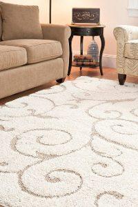 white area rug with a filigree design
